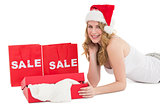 Festive blonde with sale shopping bags and present