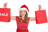 Festive blonde holding sale shopping bags