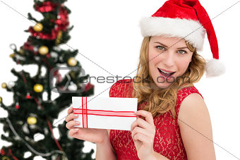 Blonde in santa hat holding a card