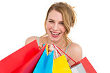Portrait of a smiling woman with shopping bags