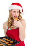 Festive blonde eating hot cookies