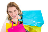 Overhead of a woman holding many shopping bags