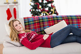 Day dreaming young woman lying on couch