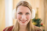 Portrait of a smiling blonde wearing earmuffs