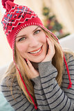 Portrait of a smiling pretty blonde in winter hat