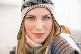 Close up of a woman in winter hat looking at the camera