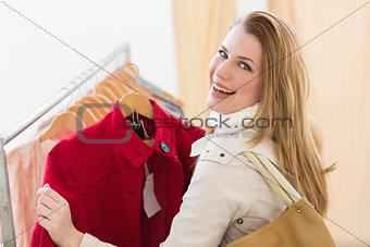 Smiling blonde picking out jacket