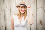Portrait of a smiling blonde wearing hat