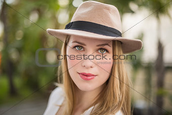Close up of a blonde woman wearing hat