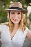 Portrait of a smiling blonde woman wearing hat