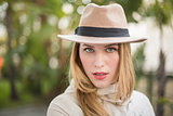 Cheerful blonde with hat posing