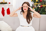 Brunette getting a headache on christmas day
