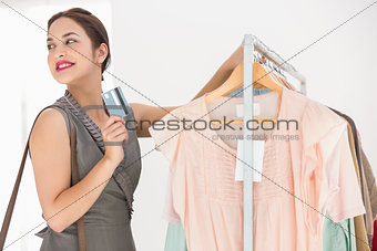 Beauty brunette leaning rail and holding credit card