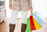 Mid section of woman holding shopping bags