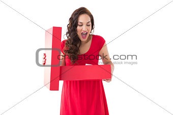 Astonished brunette holding a box