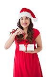 Festive brunette opening gift