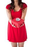 Festive brunette holding red gift