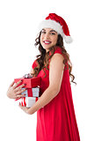 Festive brunette holding pile of presents