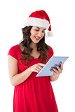 Festive brunette using her tablet pc