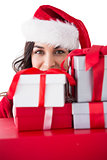 Festive brunette holding stack of gifts