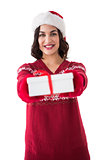Smiling brunette in red gloves holding gift
