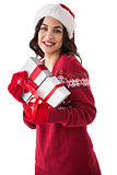 Cheerful brunette holding christmas presents