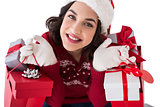 Smiling brunette holding shopping bags full of gifts