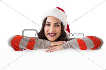 Beauty brunette in santa hat smiling at camera
