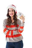 Festive brunette holding her cash