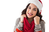 Happy brunette in winter clothes smiling at camera