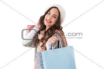 Smiling brown hair posing with shopping bags