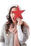 Excited brunette in winter clothes holding star