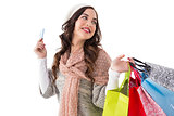 Beauty brunette holding credit card and shopping bags