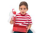 Cute little boy opening gift