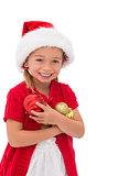 Cute little girl wearing santa hat holding baubles