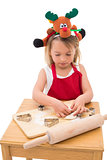 Festive little girl making cookies