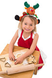 Festive little girl making cookies