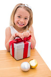 Festive little girl opening a gift