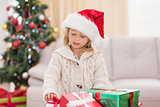 Cute little girl surrounded by christmas gifts