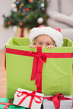 Cute little girl sitting in giant christmas gift