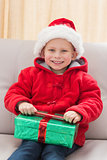 Festive little boy opening a gift
