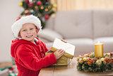 Festive little boy opening a gift