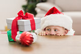 Festive little boy looking at gifts