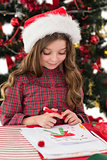 Festive little girl drawing pictures