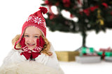 Festive little girl in hat and scarf