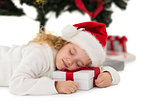 Festive little girl napping on a gift