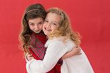 Festive little girls hugging and smiling