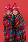 Festive little girls under a blanket
