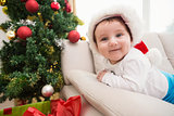 Cute baby boy on couch at christmas
