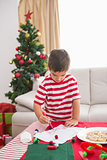 Cute boy drawing festive pictures